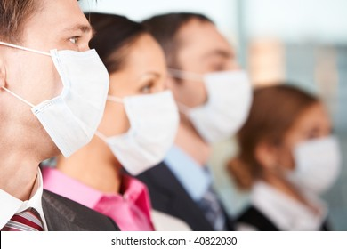 Portrait of businessman in protective mask with line of people on background