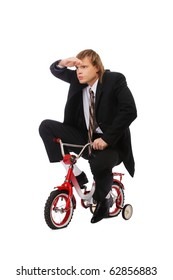 portrait of businessman riding on child's bicyce and looking forward