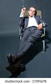 Portrait of a businessman smoking a cigar