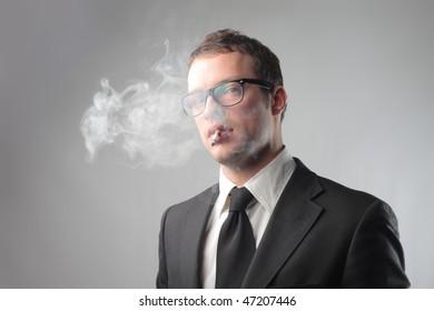 Portrait of a businessman smoking a cigarette