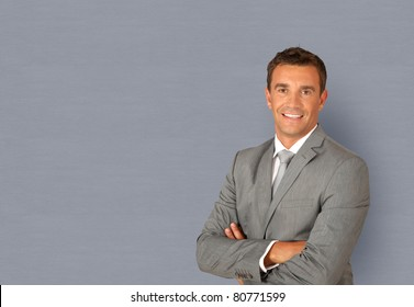 Portrait of businessman standing with arms crossed