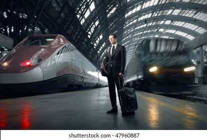 Portrait of a businessman standing on a platform of a train station