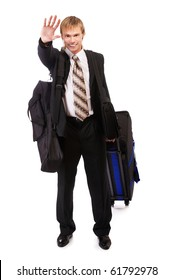 portrait of businessman in suit with bags waving hand in greeting