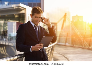 Portrait of Businessman talking on phone in financial district