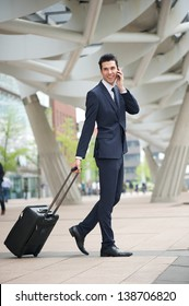 Portrait of a businessman traveling with phone and bag