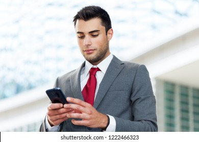 Portrait of a businessman using his mobile phone