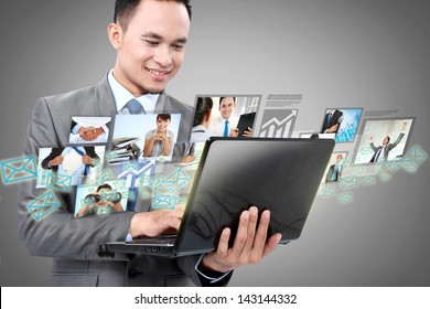 Portrait of businessman using laptop and communicating with his team across the world. International communications concept