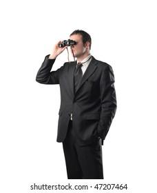 Portrait of a businessman using a pair of binoculars