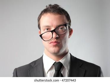 Portrait of a businessman wearing crosswise glasses
