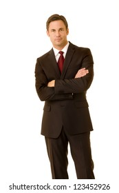 Portrait of a businessman wearing suit with his arms folded