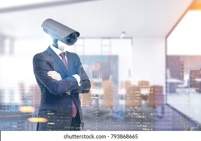 Portrait of a businessman wearing a suit and standing with crossed arms. His head is a CCTV camera. A blurred meeting room background. Toned image double exposure mock up