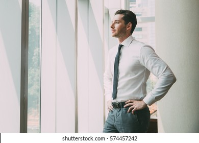 Portrait of Businessman at Window 4