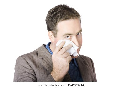 Portrait Of Businessman Wiping Face With Tissue