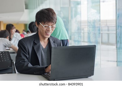 Portrait of businessman working