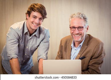 Portrait of businessmen smiling in office