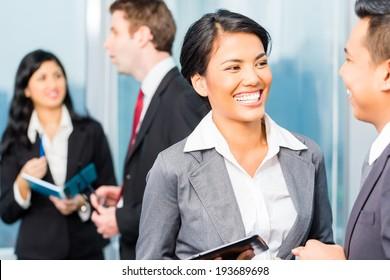 Portrait of businesspeople talking