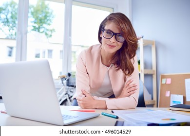 Portrait of businesswoman at her office looking with confidence at camera