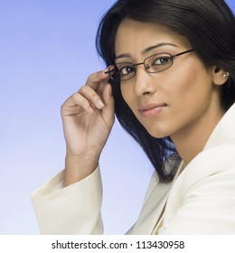 Portrait of a businesswoman holding her eyeglasses