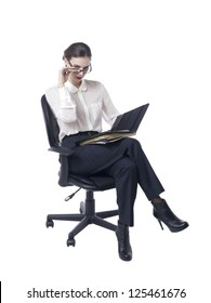 Portrait of businesswoman holding her files while sitting in a chair against white background