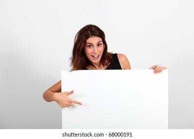 Portrait of businesswoman holding whiteboard