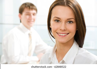 Portrait of businesswoman looking at camera in working environment