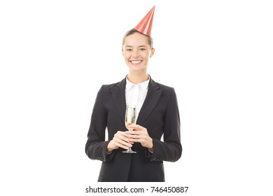 Portrait of businesswoman in party hat celebrating birthday at office