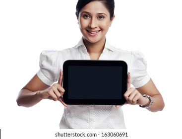 Portrait of a businesswoman showing a digital tablet and smiling