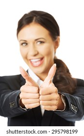Portrait of businesswoman showing thumbs up.