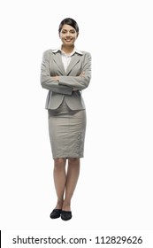 Portrait of a businesswoman standing against a white background