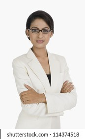 Portrait of a businesswoman standing with arms crossed