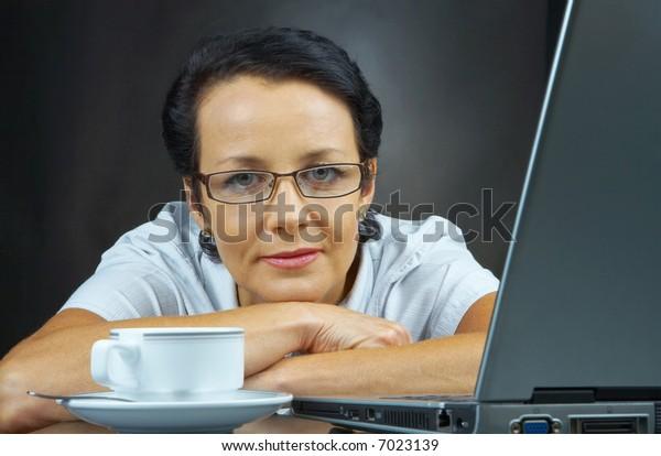 portrait of  businesswoman in stylish glasses posing on black back