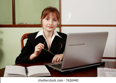 Portrait of a businesswoman when working. Shot in studio.