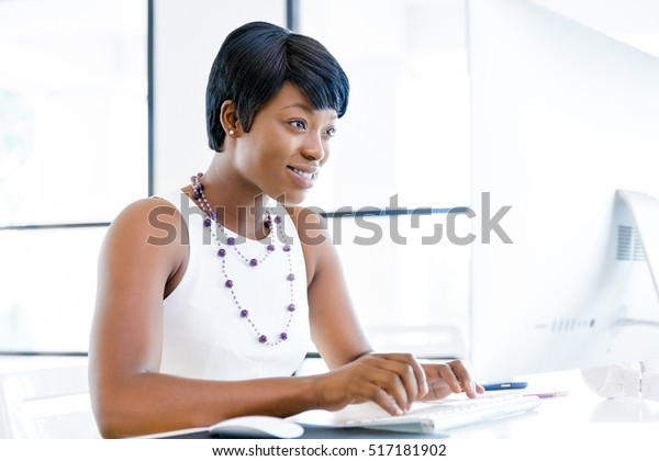 Portrait of businesswoman working at her desk in office