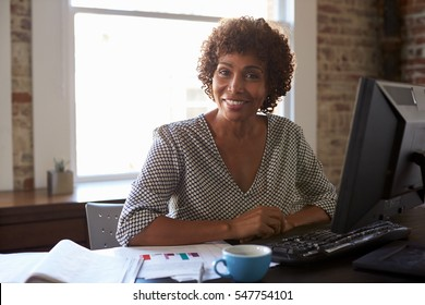 Portrait Of Businesswoman Working In Office