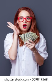 Portrait of a businesswomen in white shirt with money on grey background.