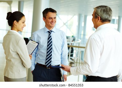 Portrait of busy people discussing new working plan or idea
