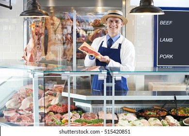 Portrait Of Butcher Standing Behind Counter
