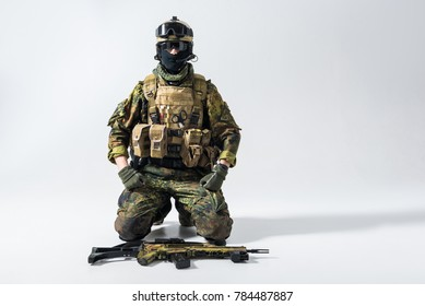 Portrait of calm defender locating near weapon while watching at camera. Profession concept. Copy space