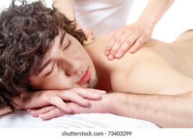 Portrait of calm guy enjoying the procedure of massage