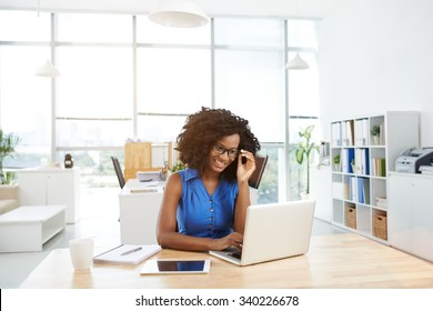 Portrait of Canadian business woman working in the office