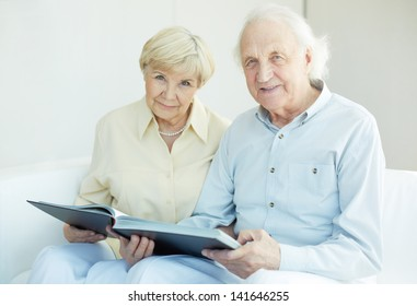 Portrait of a candid senior couple looking at camera at leisure