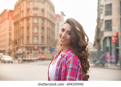 Portrait of carefree girl walking in big city