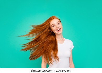Portrait of careless, carefree lady isolated on vivid teal background turn head and make light, airy hair, white beaming smile
