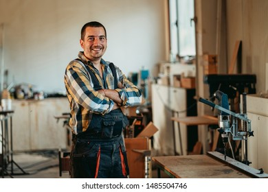 Portrait of carpenter posing for the camera in his workshop