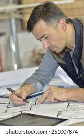 Portrait of carpernter designing plans