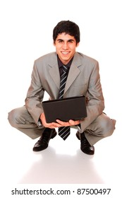 Portrait of casual businessman with laptop on white background