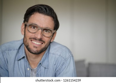 Portrait of casual handsome man wearing designer glasses