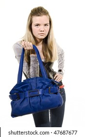 Portrait of a casual woman with handbag. blue leather