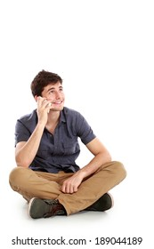 Portrait of a casual young man speaking on the phone and smiling to the camera