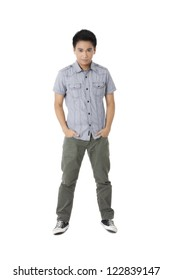 Portrait of a casual young man standing with hands on the pocket over the white background